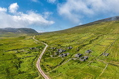 """""""The Deserted Village of Slievemore"""" (Gareth Wray - 13 Million Views, Thank You) Tags: foot tours cliffs sea achil achill island dji phantom 4 four p4p pro drone aerial uav slievemore deserted famine village pano panoramic town abandoned ruin ghost summer landscape landmark way tourist attraction tourism tour historic history visit wild atlantic mayo ireland irish scenic gareth wray photography day vacation 2019 hill thatched stone lost grass clouds drive wildatlanticway sunny county postcard rocks green sound"""