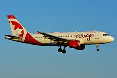 C-FYIY (Air Canada - rouge) (Steelhead 2010) Tags: aircanada airbus yul creg cfyiy a319 a319100