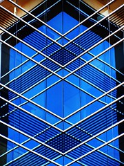 Symmetrical Inside Corner (2n2907) Tags: abstract reflection glass office building windows skyscraper architecture graphic geometric geometry pattern lines graphical design blue triangle triangles diagonal diamonds inside corner symmetrical symmetry