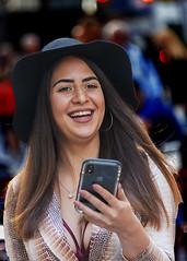 Portrait (D80_544009) (Itzick) Tags: manhattansep2019 nyc candid colour colorportrait streetphotography smile cellphone face facialexpression portrait youngwoman brunette d800 itzick