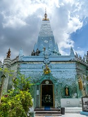 Wide View Mirror Temple in Rangoon, Burma with Rain Clouds threatening overhead (vertical)