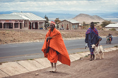 On My Way (u c c r o w) Tags: goat tanzania maasai orange herdsman road street streetlife urban urbanlife portrait africa african