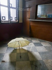 Umbrella Lies Drying on Floor of Post Office, Rangoon