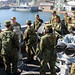 Basic English Enhancement course students from JGSDF tour the amphibious transport dock ship USS Green Bay
