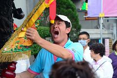 Worshipper with a Flag (Bob Hawley) Tags: asia chiayicounty taiwan nikond7100 nikon28105mmf3545afd people religion taoism buddhism ceremonies fanlutownship bantianyanziyuntemple worshipping taiwanesemen banners screaming