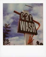 At The... (tobysx70) Tags: polaroid originals color 600 instant film slr680 at the lakeside car wash west riverside drive burbank california ca neon sign red arrow palm trees blue sky clouds googie style architecture sx70 expired sx70sonar sonar tele15 lens prospect avenue east hollywood los angeles la yellow rose royce song toby hancock photographytoby photography