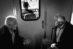 Travelling (Roberto Spagnoli) Tags: biancoenero blackandwhite bw travel viaggio friends friendship conversation train treno people oldpeople italy hands everydaylife