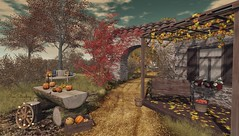 You are arriving in our small town, Welcome! (Rose Sternberg) Tags: deco decor home garden interior outdoor second life november 2019 exclusive for the liaison collaborative sways remo brick archway with shingle roof lukas autumn porch floor leaves window box bench basket apples amber half circular pumpkin carving bowl scraps knife strump seat bucket hazel wagon wheel string lights little branch tulip tree eucy shrub red leaf crispy grass happy mood dirt road fall