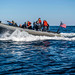 Sailors aboard the USS Milius conduct training in a rigid hull inflatable boat