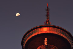 The moon is touching the tower... (born to be an artist) Tags: tower greece sunrise red light moon beautiful pov photography harmony calmness mountain parnitha antennas windows view lookingup warmth sunslight sky modernarchitecture tall