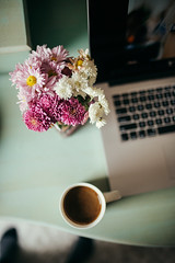 Coffee and colorful flowers on work desk. (shixart1985) Tags: antique beautiful coffee cup daylight decoration drinking education flowers glamour headboard home indroors learn learning macbook morning morningnotebook one person pillow reading relaxation rustic vintage wooden