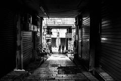 Tunnel of Jerusalem (Isidre Cor) Tags: fuji x100 bn monochrome street photography blanco y negro fotografia callejera people gente isidre cor hyperfocal santa tierra israel land holy religion jerusalen jerusalem