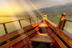 At The First Light Of Day (Alfred Grupstra) Tags: woodmaterial sea nature lake outdoors water sunset landscape scenics mountain nauticalvessel nopeople travel vacations sky pier sunlight summer tranquilscene sunrisedawn lakekerkini greece