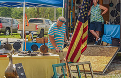 Might Get This As Well (risingthermals) Tags: united states america usa north americans people humans humanity candid street photography country everyday life scenes capture events experiences unposed natural yard garage sale selling outside flag man looking trailer ky kentucky tn tennessee