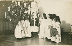 Santa and Coeur d'Alene Tribe Children at Sacred Heart Mission, circa 1910 - DeSmet, Idaho (Shook Photos) Tags: postcard postcards rppc realphotopostcard realphotopostcards sacredheartmission coeurdalenetribe indian nativeamerican indians nativeamericans reservation desmetidaho desmet idaho benewahcounty tribe tribal santa christmas kids children girls females doll christmastree catholic religion romancatholic fatherchristmas saintnicholas stnicholas