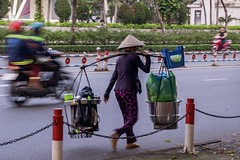 Ho Chi Minh City street photo (billcoo) Tags: saigon fujifilm motorcycle xf1855mm travel xh1 1855mm fuji fujinon woman vendor