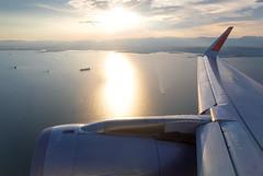 JA22JJ Jetstar Japan A320 (twomphotos) Tags: landing wing view inflightimpressions reflection sunset evening jetstar japan airbus a320