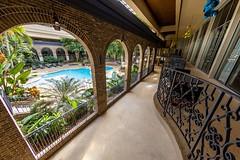 Oasis (Karen_Chappell) Tags: travel pool hotel interior architecture wideangle fisheye canonef815mmf4lfisheyeusm atlanta usa railing arches arch blue green building georgia sheraton bricks windows