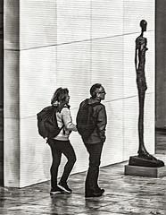 Patrons visits Art At MoMA (nrhodesphotos(the_eye_of_the_moment)) Tags: dsc00113001084 wwwflickrcomphotostheeyeofthemoment theyeofthemoment21gmailcom moma museum art blackandwhite patrons exhibits garden outdoors shadows reflections wall sculpture manhattan nyc man woman