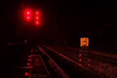 After midnight at a passenger train stop in the middle of nowhere, West Virginia (sniggie) Tags: amtrakstation prince westvirginia rail railroad railroadtrafficlights redlights stop red