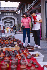 Shopping for Teapots (Taomeister) Tags: ektachromee100 contaxg2 tianjinchina newektachrome kodake100
