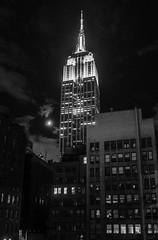 Empire Moon (Hector Patrick) Tags: flickrelite fujifilmx100f lightroomclassic newyork nyc flickr fuji bnw noiretblanc blancoynegro absoluteblackandwhite skyscraper architecture empirestatebuilding architektur