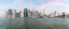 Rainbow over South Manhattan seen from east river (Gilles B. Photographe) Tags: manhattan east us city tourist panorama architectural modern office rainbow midtown state architecture skyline building sunset pier landmark harbor cityscape metropolitan town urban skyscrapers usa york nyc american ny water center financialdistrict background finance panoramic contemporary scenic outdoors boat america downtown view newyork waterfront metropolis buildings outdoor world bridge financial clouds big exterior blue skyscraper travel newyorkcity river tower lowermanhattan new bigapple business suspension tourism sky famous
