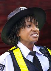 Portrait (D80_544793) (Itzick) Tags: manhattansep2019 nyc candid colorportrait color portrait guard hat blackbackground face facialexpression d800 itzick