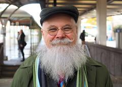 A.J. (jeffcbowen) Tags: aj stranger portrait thehumanfamily toronto transit ttc subway hat glasses beard moustache smile broadview