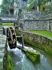 Water flowing  quickly (color raimbow) Tags: water flowing quickly park river time green blue nature italy old millwheel oldwalls
