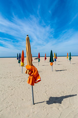 The beach of Les Planches in Deauville in Normandy in France (Gilles B. Photographe) Tags: normandie sunny sand normandy promenade nature water day tourist recreation holiday sea deauville summer beach ocean touristic les coastal sky view holidays landscape decor landmark outdoor vacation romance planches travel famous touristy coastline tourism symbol french europe france seaside wallpaper calvados destination coast colorful