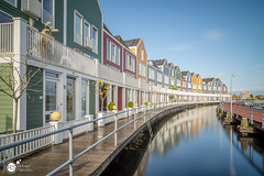 Wooden Rainbowhouses II (Robert Stienstra Photography) Tags: houten houses residence woodenhouses rainbowhouses longexposure longexposurephotography long exposure architecture architectural architecturalphotography modernarchitecture utrecht colourfull colors colours reflections reflecting lee filter leefilter bigstopper nikon waterfront waterscape cityscape cityscapes boardwalk
