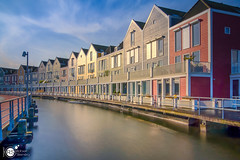 Wooden Rainbowhouses III (Robert Stienstra Photography) Tags: houten houses residence woodenhouses rainbowhouses longexposure longexposurephotography long exposure architecture architectural architecturalphotography modernarchitecture utrecht colourfull colors colours reflections reflecting lee filter leefilter bigstopper nikon waterfront waterscape cityscape cityscapes boardwalk