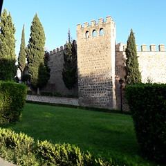 City  walls, Toledo (d.kevan) Tags: toledo citywalls grass plants trees tower battlements xiiithcentury cypresses stone streetlamps architecturaldetails