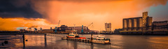 The port of Bayonne (Gilles B. Photographe) Tags: france bayonne color architectural industrial water river industry urban panorama background structure cloudy basque landscape aquitaine country adour construction french town panoramic european architecture building sky europe atlantic colorful