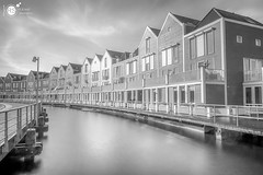 Wooden Rainbowhouses BW (Robert Stienstra Photography) Tags: houten houses residence woodenhouses rainbowhouses longexposure longexposurephotography long exposure architecture architectural architecturalphotography modernarchitecture utrecht colourfull colors colours reflections reflecting lee filter leefilter bigstopper nikon waterfront waterscape cityscape cityscapes boardwalk