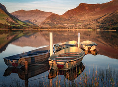 Still reflection at sunset (Anthony White) Tags: boats reflection wales snowdonia trees sunset grass