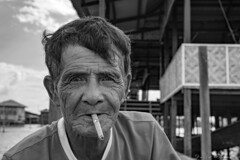 Portrait - Burmese Man (Daveoffshore) Tags: man burmese myanmar smoking cigar cigarette monochrome intense focus david ferguson daveoffshore daveoffshorenetscapenet