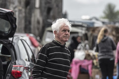 Bargain hunter at the carboot sale (Frank Fullard) Tags: frankfullard fullard candid street portrait bargain hunter carboot sale color colour castlebar mayo irish ireland stripes jumper whitehair car