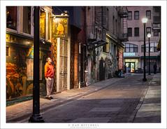 Outside The Vesuvio Cafe (G Dan Mitchell) Tags: lone man stand sidewalk street alley night vesuvio cafe cocktails light sanfrancisco sf california usa north america urban photography gritty alone grafitti