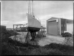 sailing vessel, on stands, scaffolding II, Lyman Morse Boatyard, Thomaston, Maine, Mamiya 645 Pro, mamiya sekor 45mm f-2.8, Bergger Pancro 400, Moersch Eco developer, mid September 2019 (steve aimone) Tags: sailingvessel sailboat ship onstands scaffolding lymanmorse boatyard thomaston maine mamiya645pro mamiyasekkor45mmf28 mamiyaprime primelens 645 mediumformat monochrome monochromatic blackandwhite 120 120film film midcoast berggerpancro400 moerschecofilmdeveloper