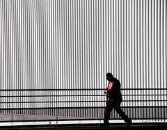 En route vers l'abstraction... (Tonton Gilles) Tags: graphisme abstrait lignes barrière motifs personnage silhouette rouge noir et blanc partiel pas ombres scène de rue