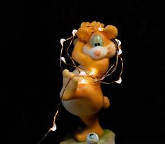 Getting ready! (Millie Cruz (On and Off)) Tags: smileonsaturday letitglow bear miniature glass lights golf ball leg canoneos5dmarkiii ef100mmf28lmacroisusm closeup brown sos hsos milliecruz flickrlounge weeklytheme christmas figurine 🎄
