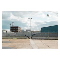 Suffling Road (John Pettigrew) Tags: lines tamron d750 nikon industrial fences buildings empty mundane documentary urban imanoot angles deserted topographics ordinary banal johnpettigrew reflections