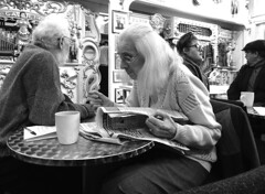 Crossword Puzzler (Snapshooter46) Tags: woman crosswordpuzzler newspaper crossword people puzzle greyhair thinking monochrome blackandwhite