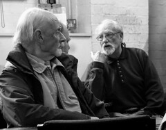 In discussion (Snapshooter46) Tags: men discussion talking conversation monochrome blackandwhite relaxing snapshot