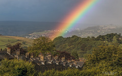 The difference of a few metres (Through_Urizen) Tags: category citiestowns england haworth landscape places rainbow westyorkshire yorkshire greatbritain uk unitedkingdom canon canon70d canon1585mm valley hiils weather rain clouds trees houses street town