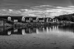 Holiday Homes, Wells-next-the-Sea (Bryan Appleyard) Tags: water holiday homes chalets sky clouds trees reflections norfolk wellsnextthesea d850 nikon monochrome blackandwhite summer