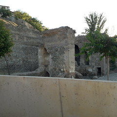 Ruined section of city walls, Toledo (d.kevan) Tags: ruins citywalls toledo stone arches architecturaldetails plants trees buildings bricks towers xiiithcentury