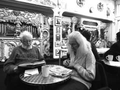Crossword Puzzler (Snapshooter46) Tags: woman crosswordpuzzler newspaper crossword people puzzle greyhair thinking couple monochrome blackandwhite